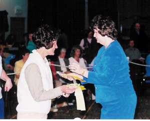 Jacque-Schatz-handing-out-sweeps-awards